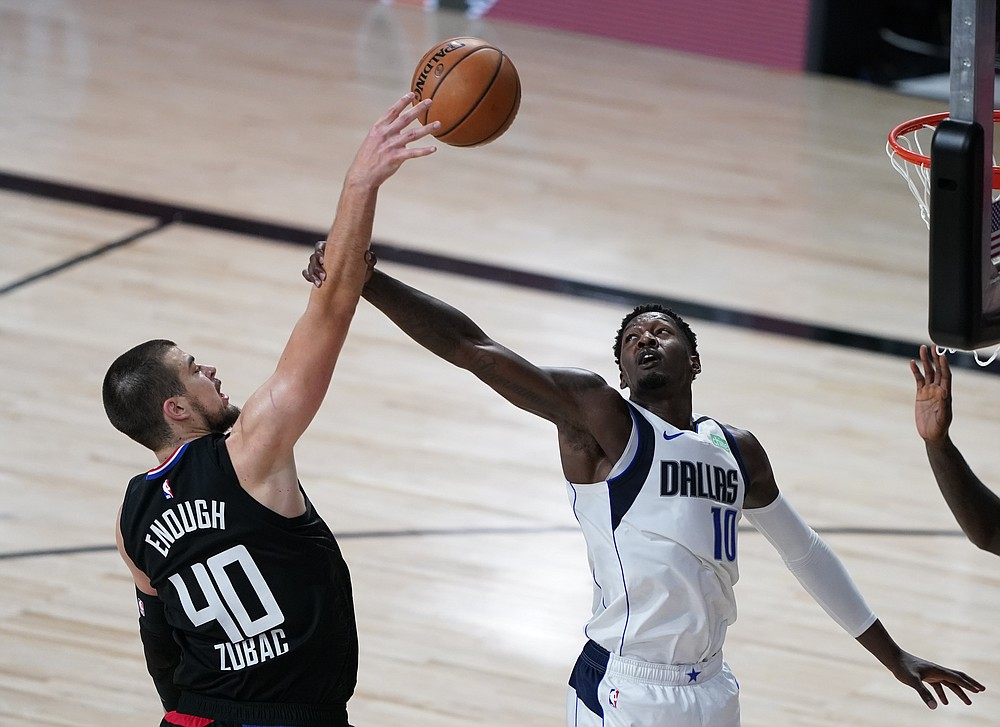 Los Angeles Clippers' Ivica Zubac (40) shoots over Dallas Mavericks' Dorian Finney-Smith (10) during the second half of an NBA first round playoff game Sunday, Aug. 30, 2020, in Lake Buena Vista, Fla. (AP Photo/Ashley Landis)