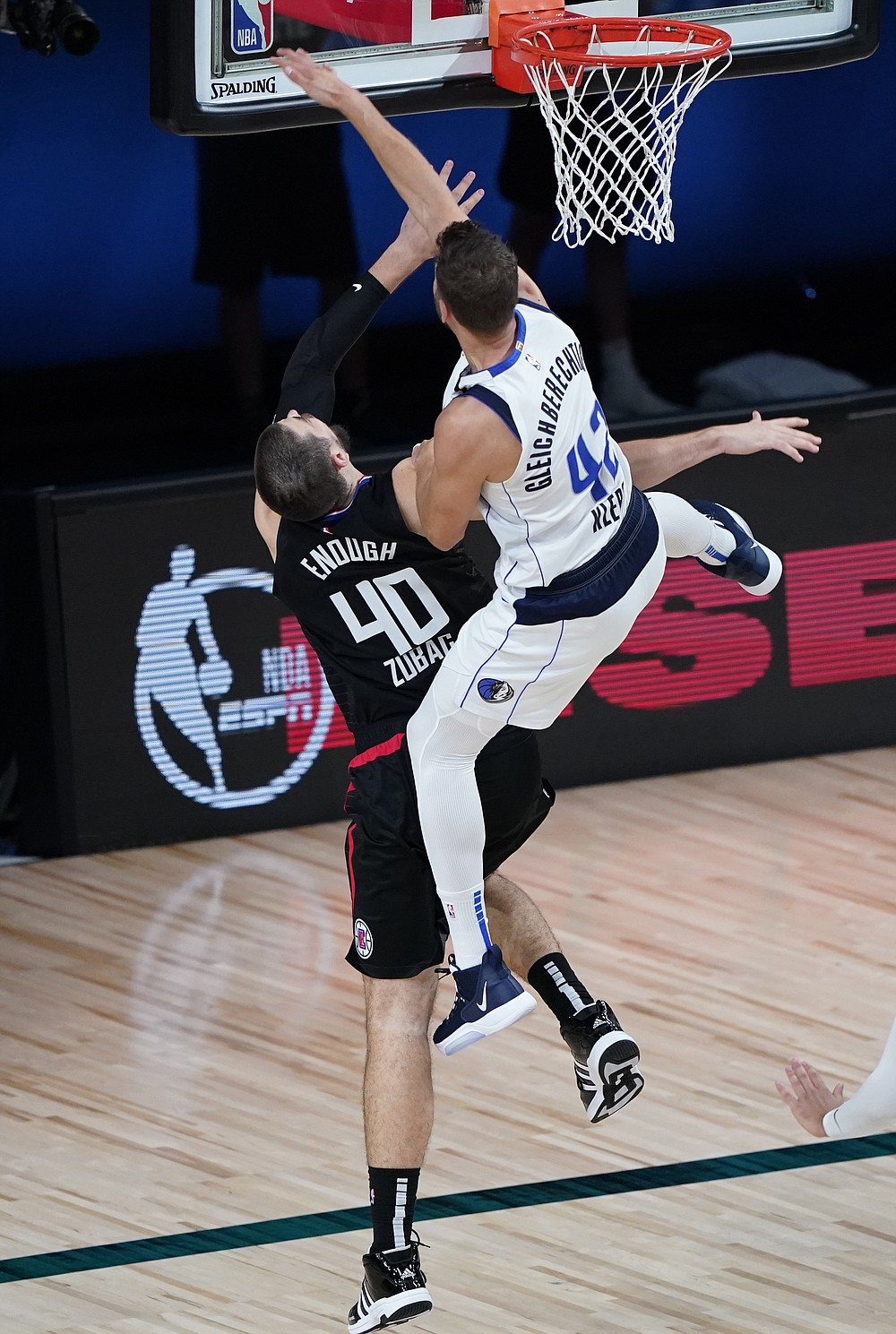 Dallas Mavericks' Maxi Kleber (42) fouls Los Angeles Clippers' Ivica Zubac (40) during the second half of an NBA first round playoff game Sunday, Aug. 30, 2020, in Lake Buena Vista, Fla. (AP Photo/Ashley Landis)
