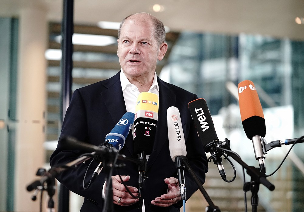 Olaf Scholz, Federal Minister of Finance and top candidate of social democrats, speaks before the SPD headquarters in a statement on the Corona demonstrations in Berlin, Germany, Sunday, Aug. 30, 2020. Over the weekend, several tens of thousands of people demonstrated in the capital against the corona measures of the federal government. This also led to clashes with the police. (Kay Nietfeld/dpa via AP)