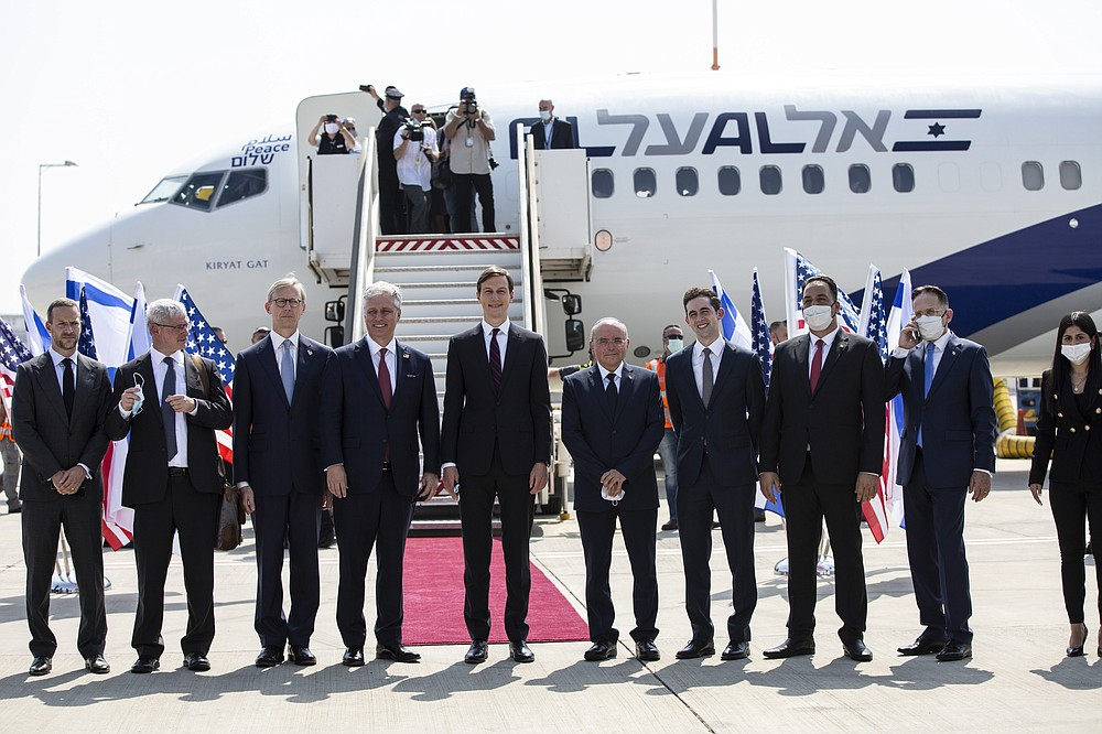 U.S. President Donald Trump's senior adviser and son-in-law Jared Kushner, center, national security adviser Robert O'Brien, fourth left, and Israeli and American delegations pose for a photo before their departure to Abu Dhabi, at Ben-Gurion Airport, in Lod, near Tel Aviv, Israel, Monday, Aug. 31, 2020. (Heidi Levine/Pool via AP).