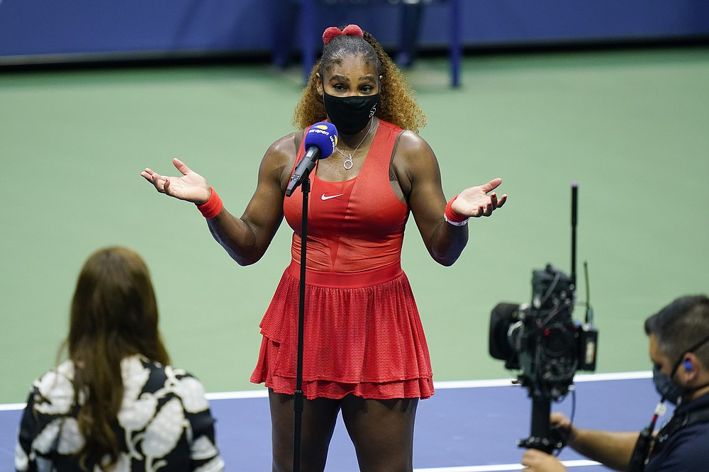 Serena Williams, of the United States, answers questions during an interview after beating Kristie Ahn, of the United States, in the first round of the US Open tennis championships, Tuesday, Sept. 1, 2020, in New York. (AP Photo/Seth Wenig)