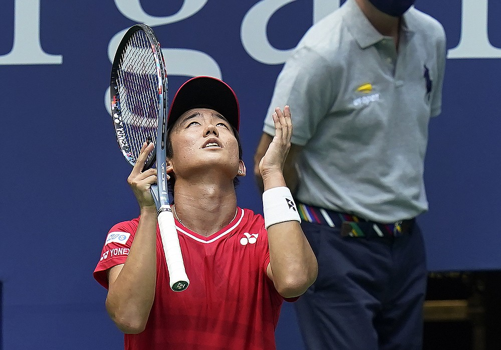 Yoshihito Nishioka, of Japan, reacts after losing a point to Andy Murray, of Great Britain, during the first round of the US Open tennis championships, Tuesday, Sept. 1, 2020, in New York. (AP Photo/Seth Wenig)