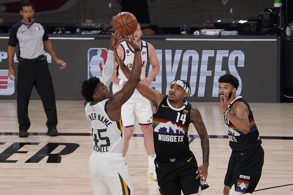 Utah Jazz's Donovan Mitchell (45) attempts a shot over Denver Nuggets' Gary Harris (14) as Jamal Murray, right, watches during the second half an NBA first round playoff basketball game, Tuesday, Sept. 1,2020, in Lake Buena Vista, Fla. (AP Photo/Mark J. Terrill)