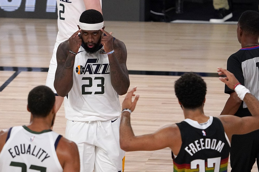 Utah Jazz's Royce O'Neale (23) celebrates with Rudy Gobert, bottom left, as Denver Nuggets' Jamal Murray (27) gestures following the foul call against his team after Gobert sunk a basket during the second half an NBA first round playoff basketball game, Tuesday, Sept. 1,2020, in Lake Buena Vista, Fla. (AP Photo/Mark J. Terrill)
