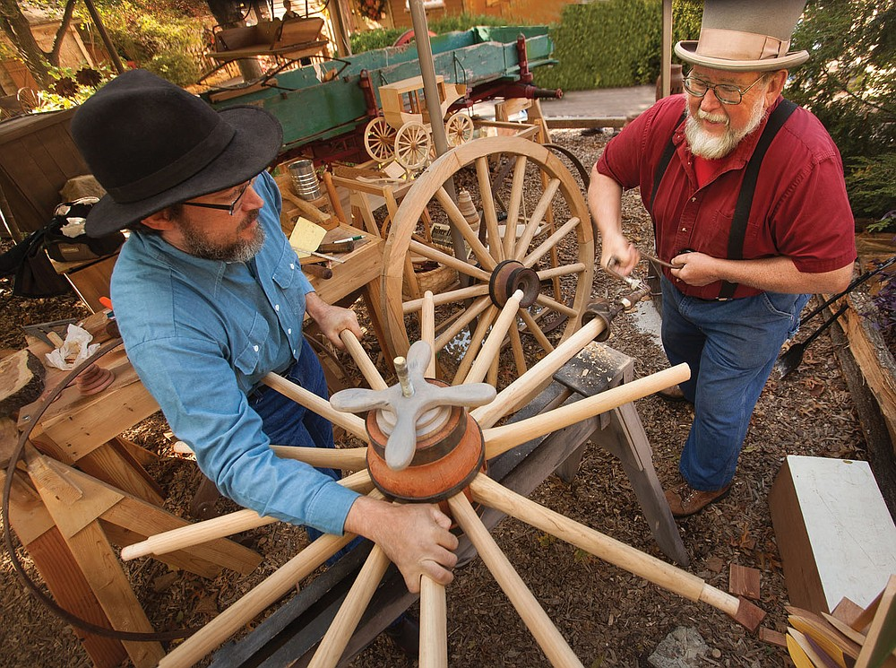 Demonstrating artists, designers and makers with high-quality, handmade, original work line the Silver Dollar City's square for the National Harvest Festival featuring Crafts, Cowboys and Pumpkins.