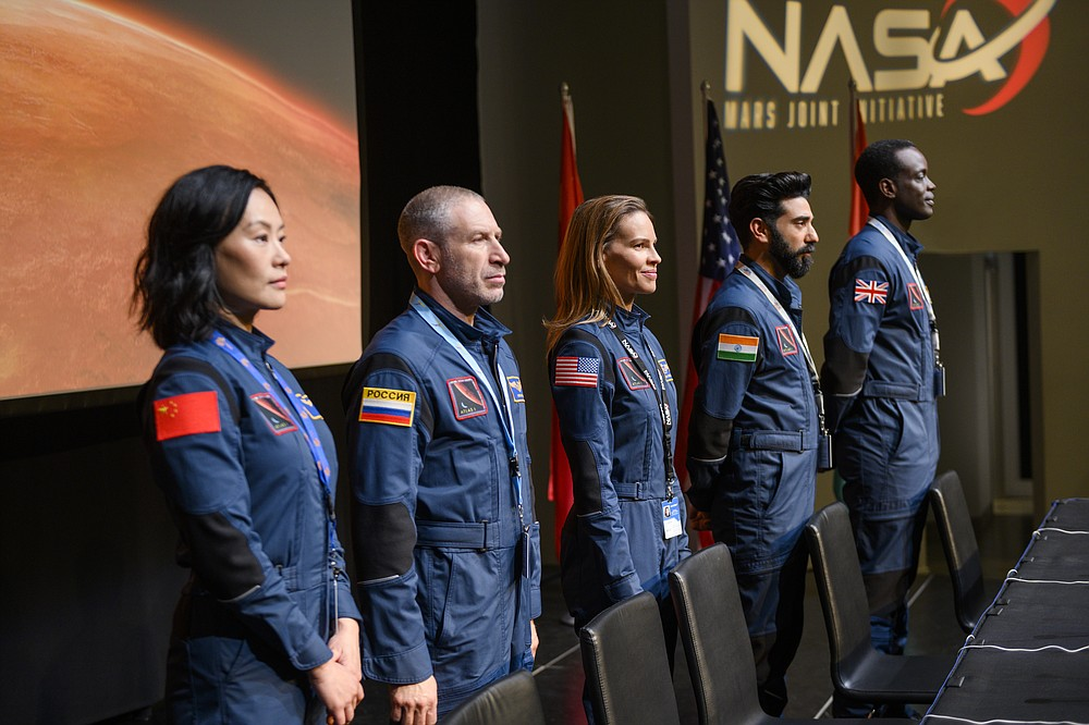 "This image released by Netflix shows, from left, Vivian Wu, Mark Ivanir, Hilary Swank, Ray Panthaki and Ato Essandoh from the new series ""Away,"" premiering on Sept. 4. (Netflix via AP)"