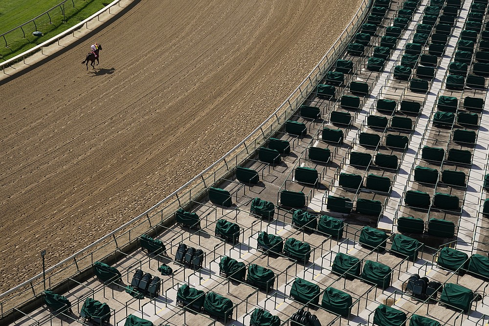 A horse heads to the starting gate for the first race of the day before the 146th running of the Kentucky Oaks at Churchill Downs, Friday, Sept. 4, 2020, in Louisville, Ky. (AP Photo/Charlie Riedel)
