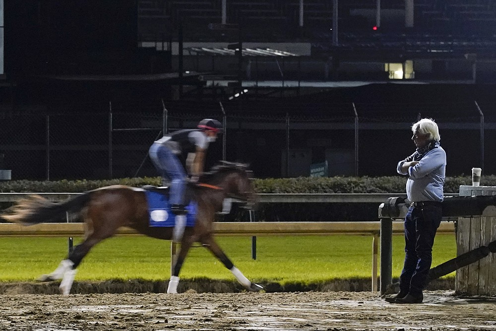 Trainer Bob Baffert watches at horses workout at Churchill Downs, Friday, Sept. 4, 2020, in Louisville, Ky. The Kentucky Derby is scheduled for Saturday, Sept. 5th. (AP Photo/Darron Cummings)
