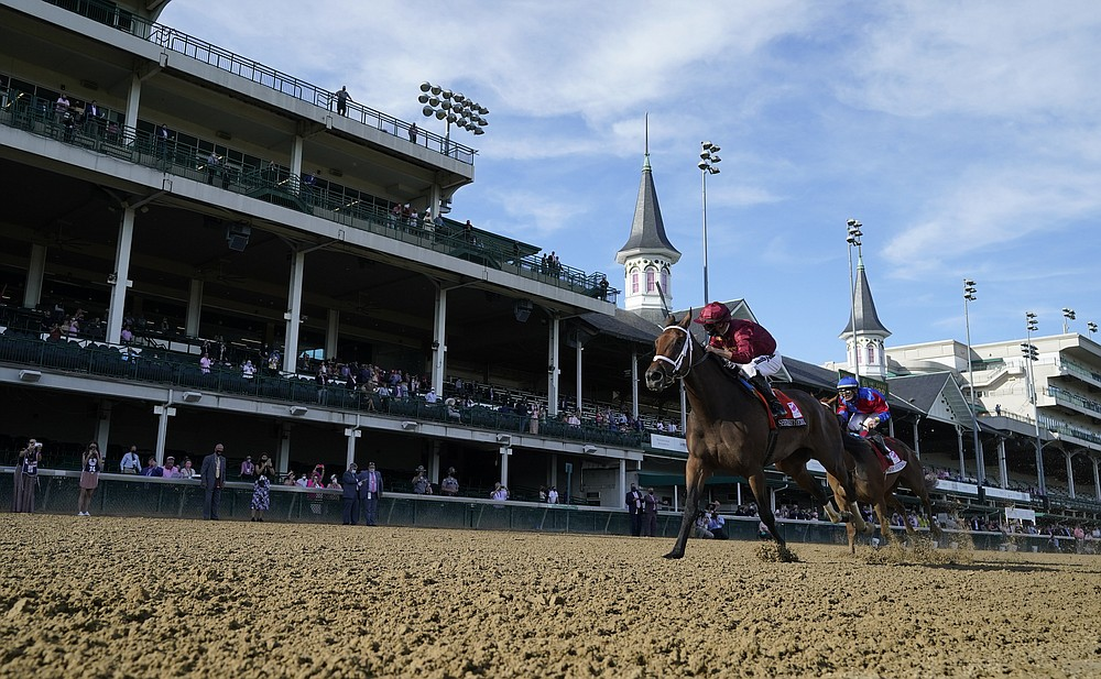 Florent Geroux riding Shedaresthedevil crosses the finish line ahead of Tyler Gaffalione on Swiss Skydiver to win the 146th running of the Kentucky Oaks at Churchill Downs, Friday, Sept. 4, 2020, in Louisville, Ky. (AP Photo/Jeff Roberson)