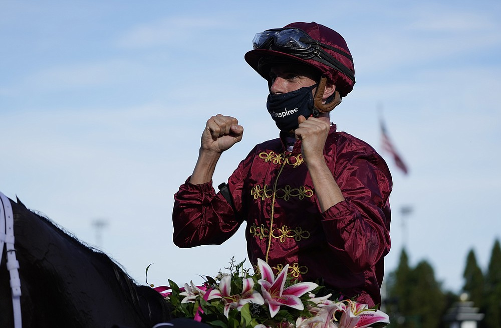 Florent Geroux on Shedaresthedevil celebrates after winning the 146th running of the Kentucky Oaks at Churchill Downs, Friday, Sept. 4, 2020, in Louisville, Ky. (AP Photo/Mark Humphrey)
