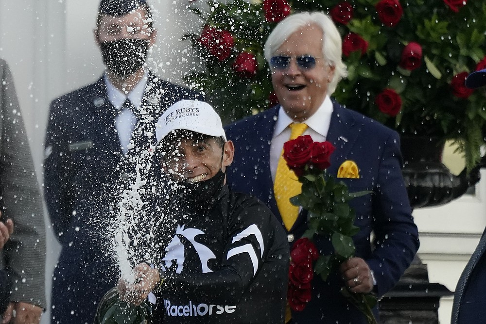 John Velazquez celebrates after riding Authentic to victory in the 146th running of the Kentucky Derby at Churchill Downs, Saturday, Sept. 5, 2020, in Louisville, Ky. (AP Photo/Jeff Roberson)