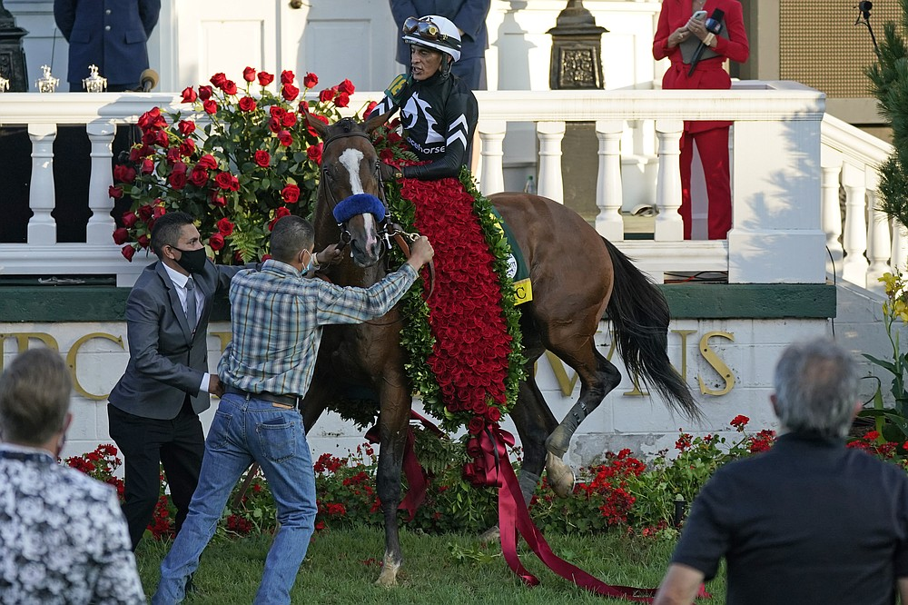 Jockey John Velazquez attempts to control Authentic in the winners' circle after winning the 146th running of the Kentucky Derby at Churchill Downs, Saturday, Sept. 5, 2020, in Louisville, Ky. (AP Photo/Jeff Roberson)
