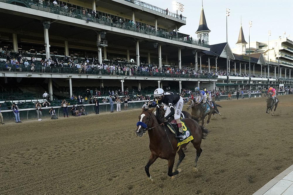 Jockey John Velazquez riding Authentic, wins the 146th running of the Kentucky Derby at Churchill Downs, Saturday, Sept. 5, 2020, in Louisville, Ky. (AP Photo/Jeff Roberson)