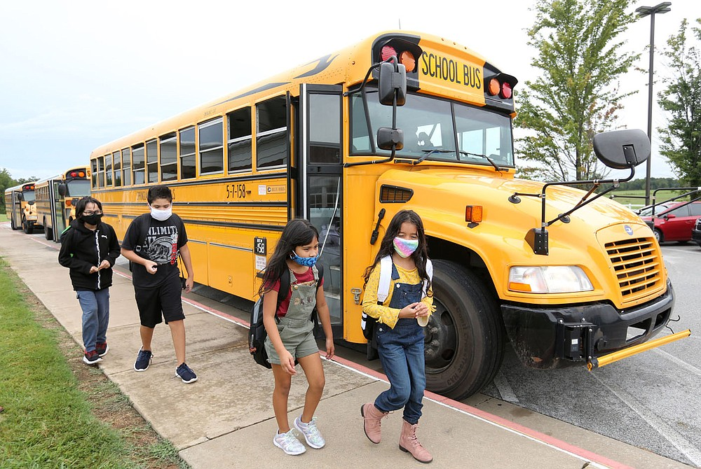 Students from Monitor Elementary School move to busses Tuesday, September 1, 2020, for a ride home in Springdale. Check out nwaonline.com/200903Daily/ and nwadg.com/photos for a photo gallery. (NWA Democrat-Gazette/David Gottschalk)