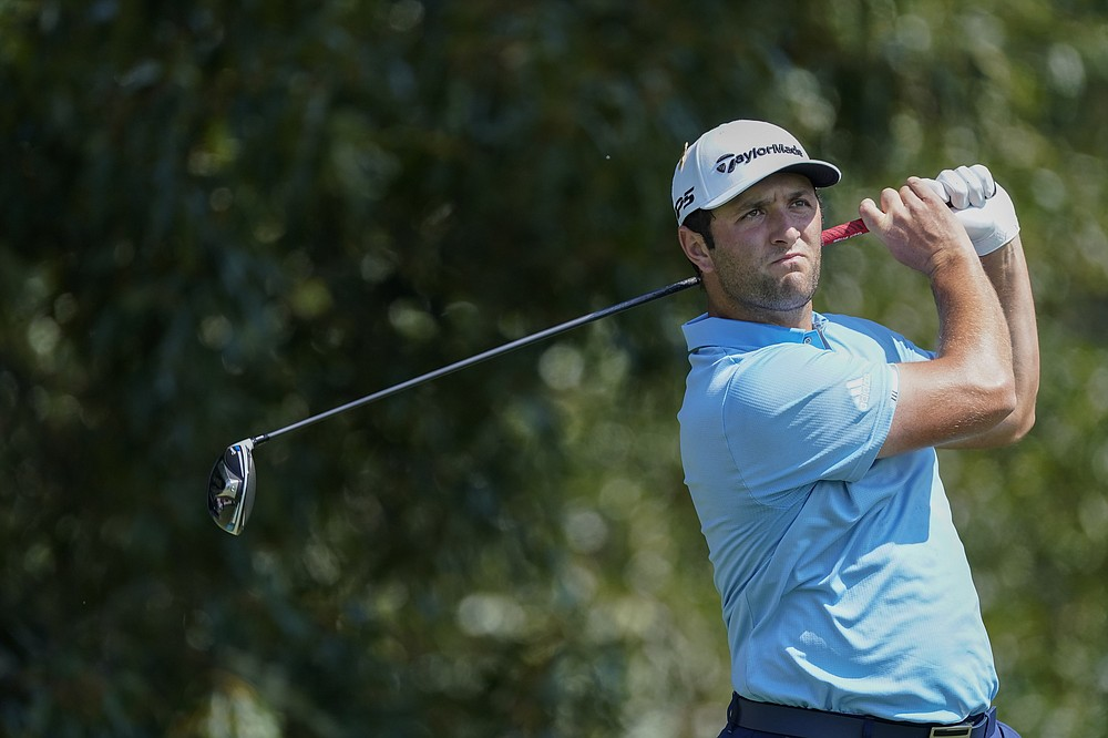 Jon Rahm watches his tee shot on the third hole during the third round of the Tour Championship golf tournament at East Lake Golf Club in Atlanta, Sunday, Sept. 6, 2020. (AP Photo/John Bazemore)