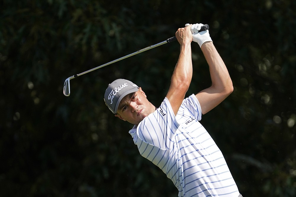 Justin Thomas hits from the tee on the third hole during the third round of play in the Tour Championship golf tournament at East Lake Golf Club Sunday, Sept. 6, 2020, in Atlanta. (AP Photo/John Bazemore)