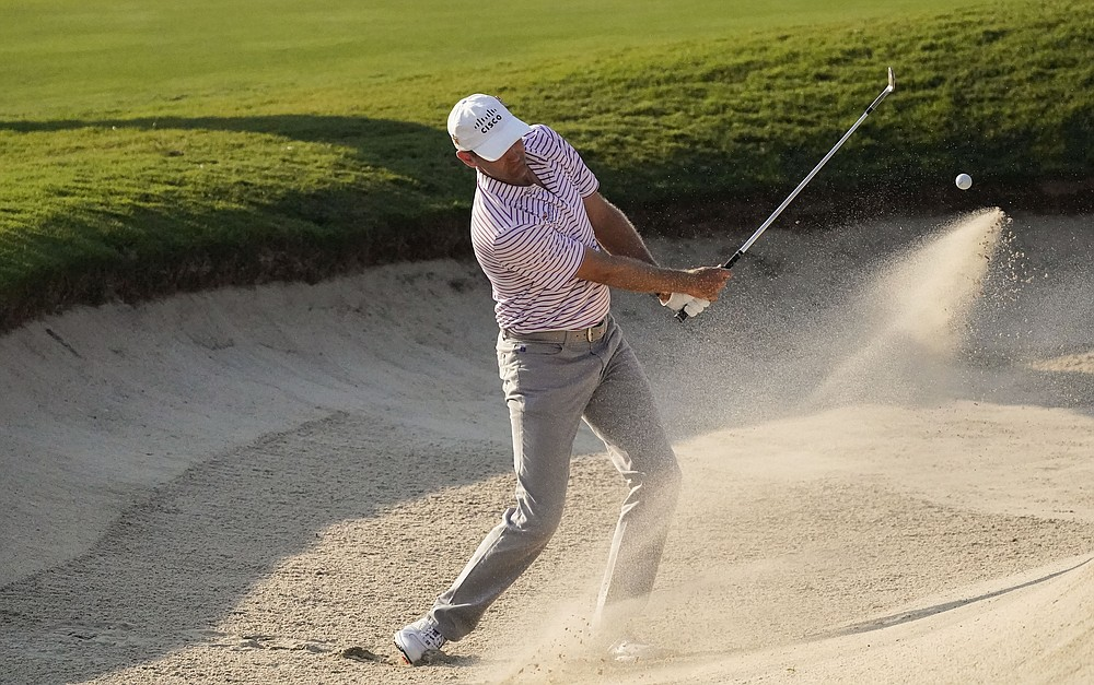 Brendon Todd hits from the bunker on the 18th hole during the third round of the Tour Championship golf tournament at East Lake Golf Club in Atlanta, Sunday, Sept. 6, 2020. (AP Photo/John Bazemore)