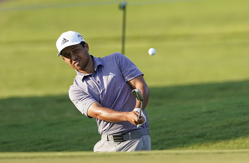 Xander Schauffele hits to the green on the 8th hole during the third round of the Tour Championship golf tournament at East Lake Golf Club in Atlanta, Sunday, Sept. 6, 2020. (AP Photo/John Bazemore)