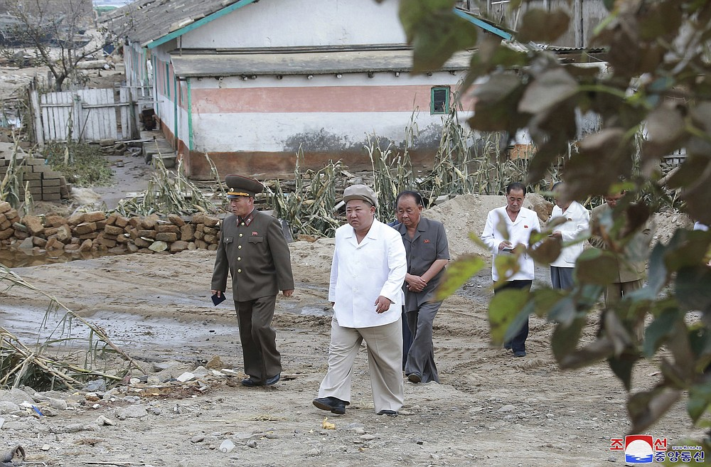 """In this Saturday, Sept. 5, 2020, photo provided by the North Korean government, North Korea leader Kim Jong Un visits a damaged area in the South Hamgyong province, North Korea, following a typhoon known as Maysak. Independent journalists were not given access to cover the event depicted in this image distributed by the North Korean government. The content of this image is as provided and cannot be independently verified. Korean language watermark on image as provided by source reads: """"KCNA"""" which is the abbreviation for Korean Central News Agency. (Korean Central News Agency/Korea News Service via AP)"""