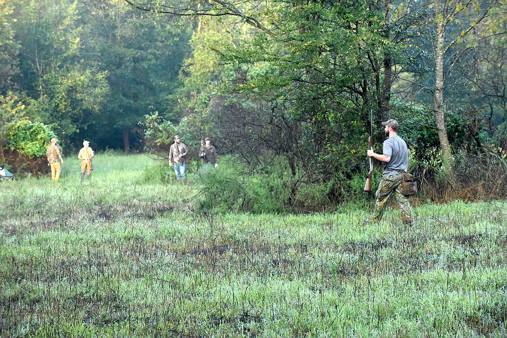 Hunters gather Sept. 5 2020 on opening morning of dove hunting season at a public field east of Siloam Springs. Arkansas Game and Fish Commission offers public dove hunting at fields east of Siloam Springs and west of Lake Wedington.  (NWA Democrat-Gazette/Flip Putthoff)