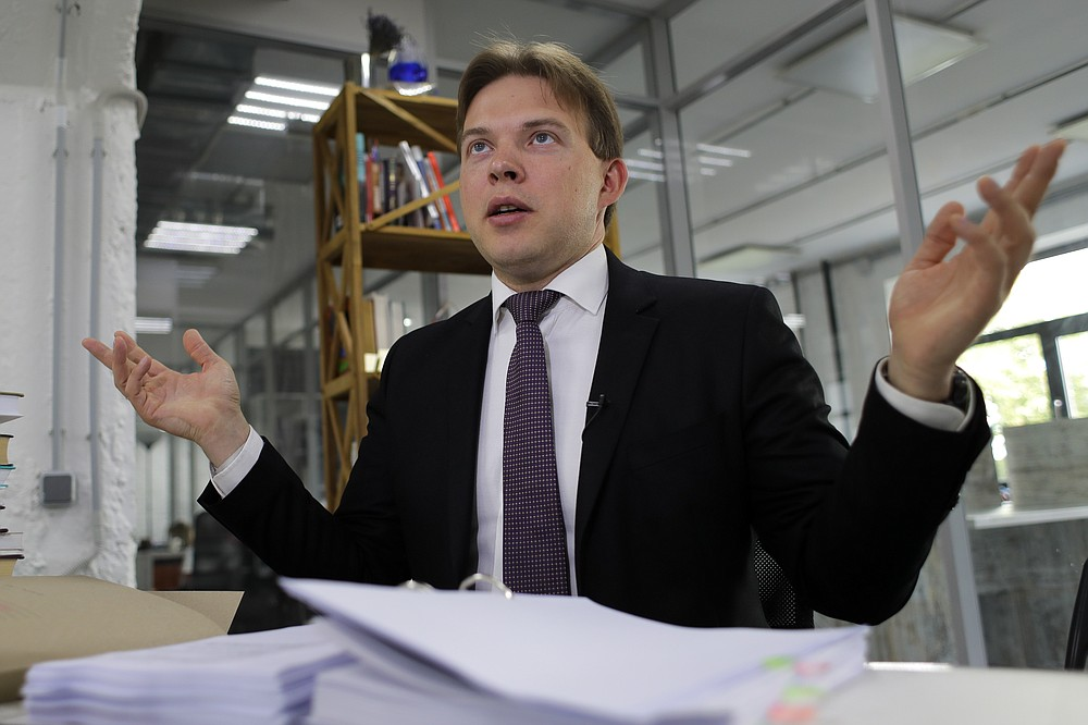 Lawyer Maxim Znak, a member of the opposition Coordination Council, which was set up after the Aug. 9 election to try to negotiate a transition of power with the government of authoritarian President Alexander Lukashenko, speaks during an interview with The Associated Press in Minsk, Belarus, Thursday, Aug. 27, 2020. Znak said the Belarus Supreme Court refused to look at 26 folders of evidence from the opposition that the election keeping Lukashenko in power was rigged. (AP Photo/Sergei Grits)
