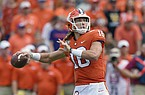FILE - In this Oct. 12, 2019, file photo, Clemson's Trevor Lawrence throws a pass during the first half of an NCAA college football game against Florida State, in Clemson, S.C. Lawrence is a candidate for the 2020 Heisman Trophy award.  (AP Photo/Richard Shiro, File)