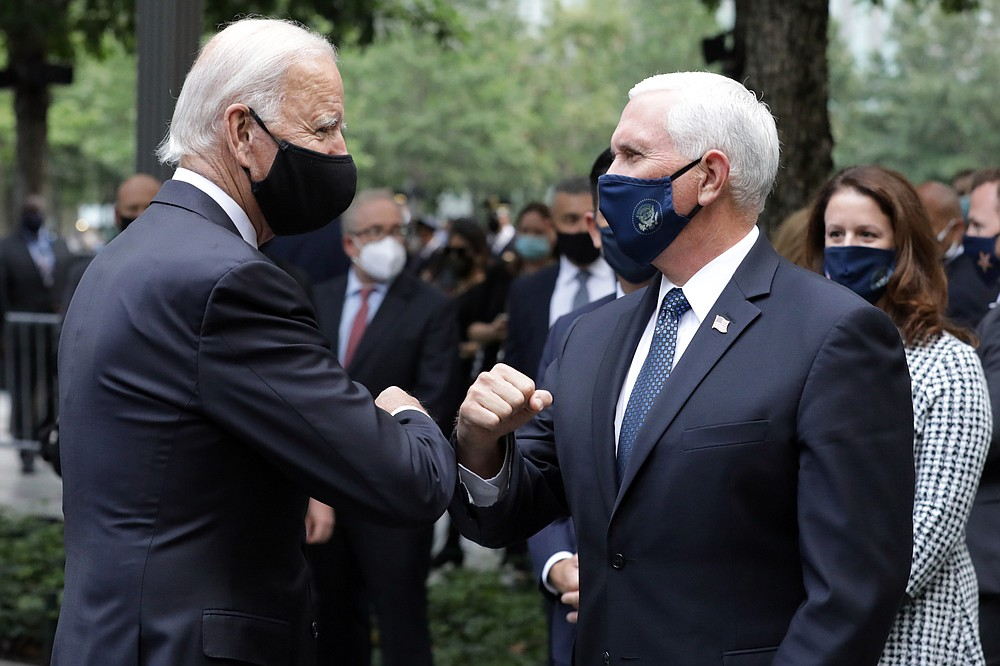Democratic presidential candidate former Vice President Joe Biden greets Vice President Mike Pence at the 19th anniversary ceremony in observance of the Sept. 11 terrorist attacks at the National September 11 Memorial & Museum in New York, on Friday, Sept. 11, 2020. (Amr Alfiky/The New York Times via AP, Pool)
