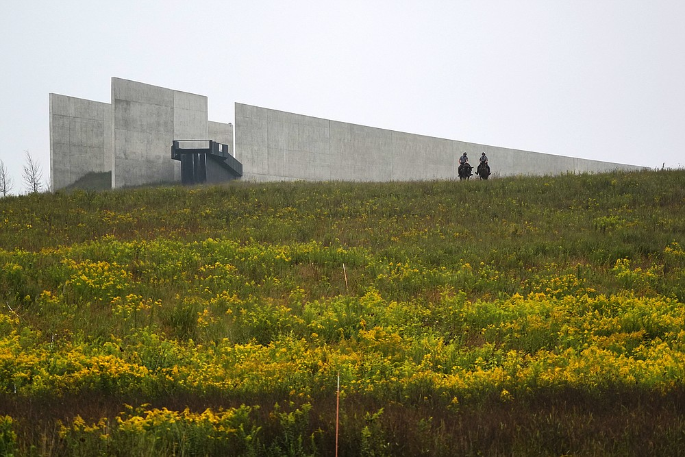 Mounted police officers sit outside the Visitor's Center at the Flight 93 National Memorial before a memorial service attended by President Donald Trump in Shanksville, Pa., Friday, Sept. 11, 2020. (AP Photo/Gene J. Puskar)
