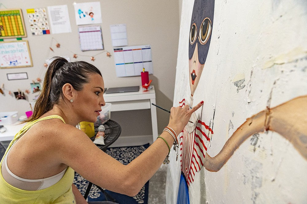Juliana Duque works on one of her painting  Monday Sept. 7 , 2020, at her home in Bella Vista. Duque did an online work share about her career Sept. 8 as part of the conclusion of a six week program put on by Artist INC that works with artists to help them be more successful as business people. (NWA Democrat-Gazette/Spencer Tirey)