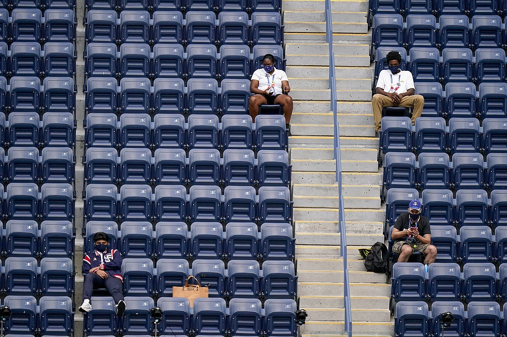 USTA event staff watch play during the women's singles final between Victoria Azarenka, of Belarus, and Naomi Osaka, of Japan, during the US Open tennis championships, Saturday, Sept. 12, 2020, in New York. (AP Photo/Frank Franklin II)