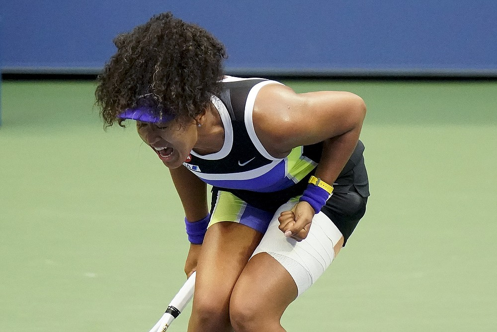 Naomi Osaka, of Japan, reacts during the women's singles final against Victoria Azarenka, of Belarus, during the US Open tennis championships, Saturday, Sept. 12, 2020, in New York. (AP Photo/Frank Franklin II)
