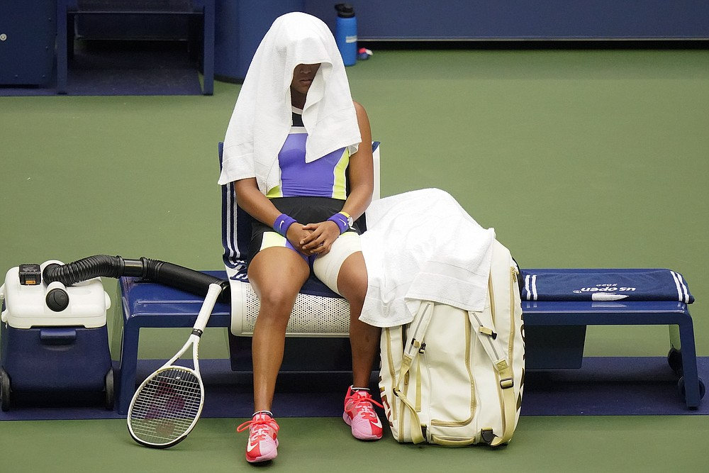 Naomi Osaka, of Japan, takes a break between sets against Victoria Azarenka, of Belarus, during the women's singles final of the US Open tennis championships, Saturday, Sept. 12, 2020, in New York. (AP Photo/Frank Franklin II)