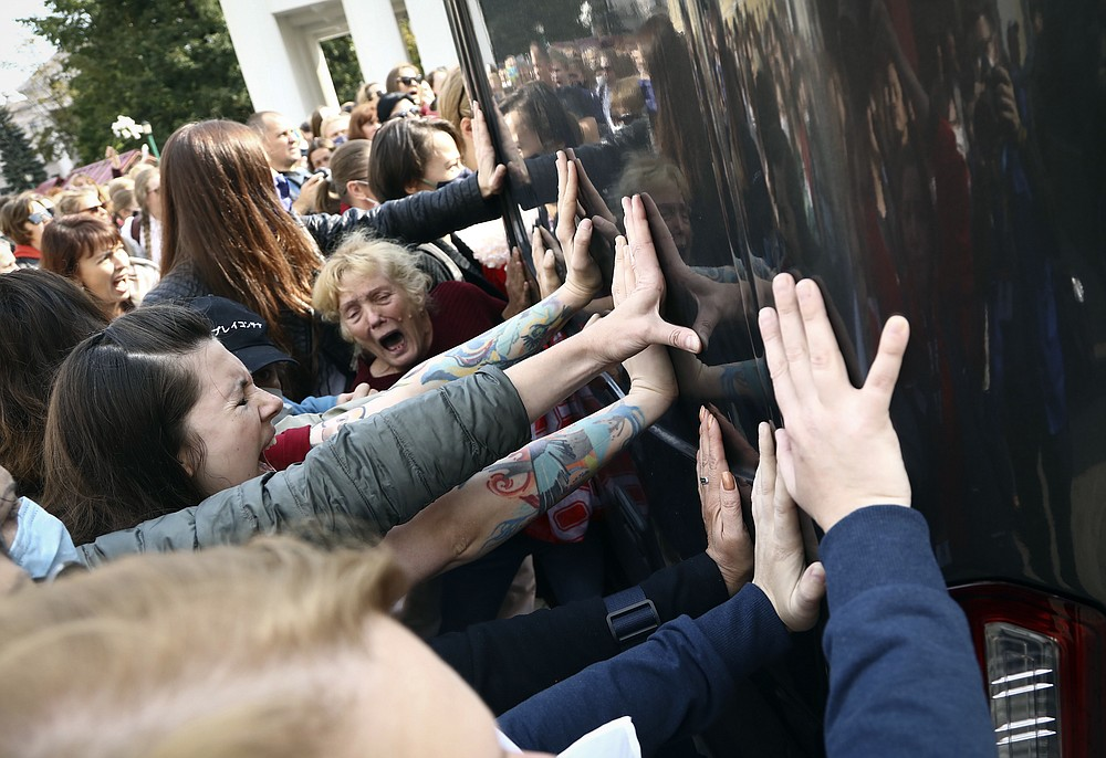 Women block a police bus during an opposition rally to protest the official presidential election results in Minsk, Belarus, Saturday, Sept. 12, 2020. (Tut.by via AP)