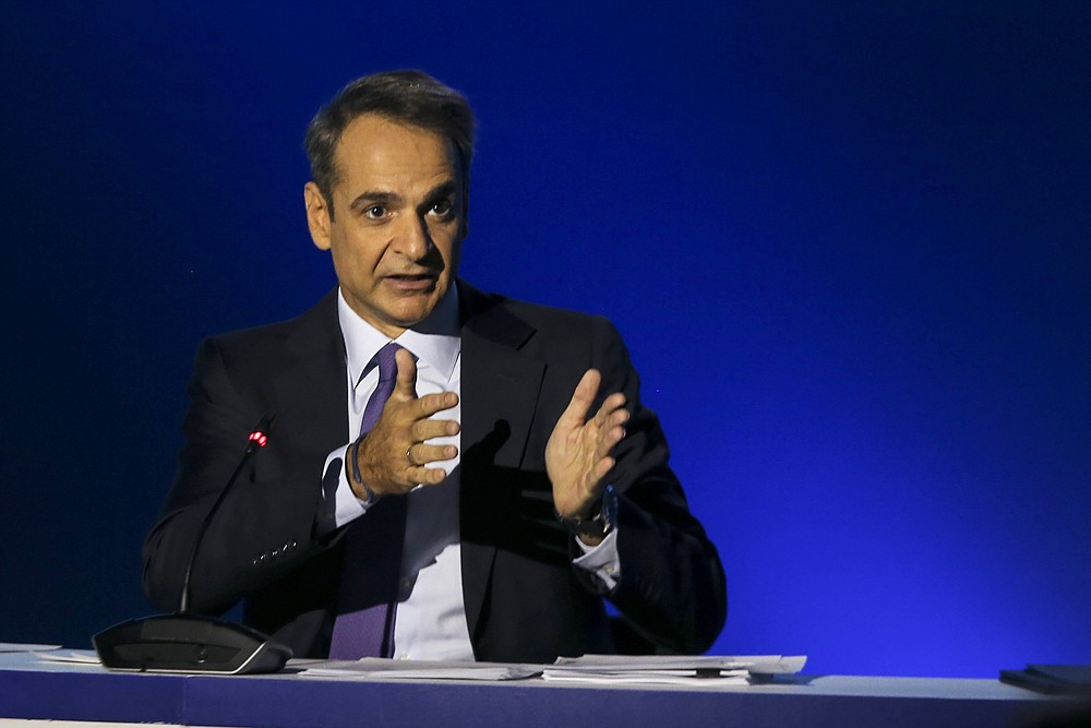 Greece's Prime Minister Kyriakos Mitsotakis addresses journalists during a news conference in the northern city of Thessaloniki, Greece, Sunday, Sept. 13, 2020. Mitsotakis outlined plans Saturday to upgrade the country's defense capabilities, including purchases of new fighter planes, frigates, helicopters and weapons systems, amid heightened tensions with neighboring Turkey over rights to resources in the eastern Mediterranean. (AP Photo/Giannis Papanikos)