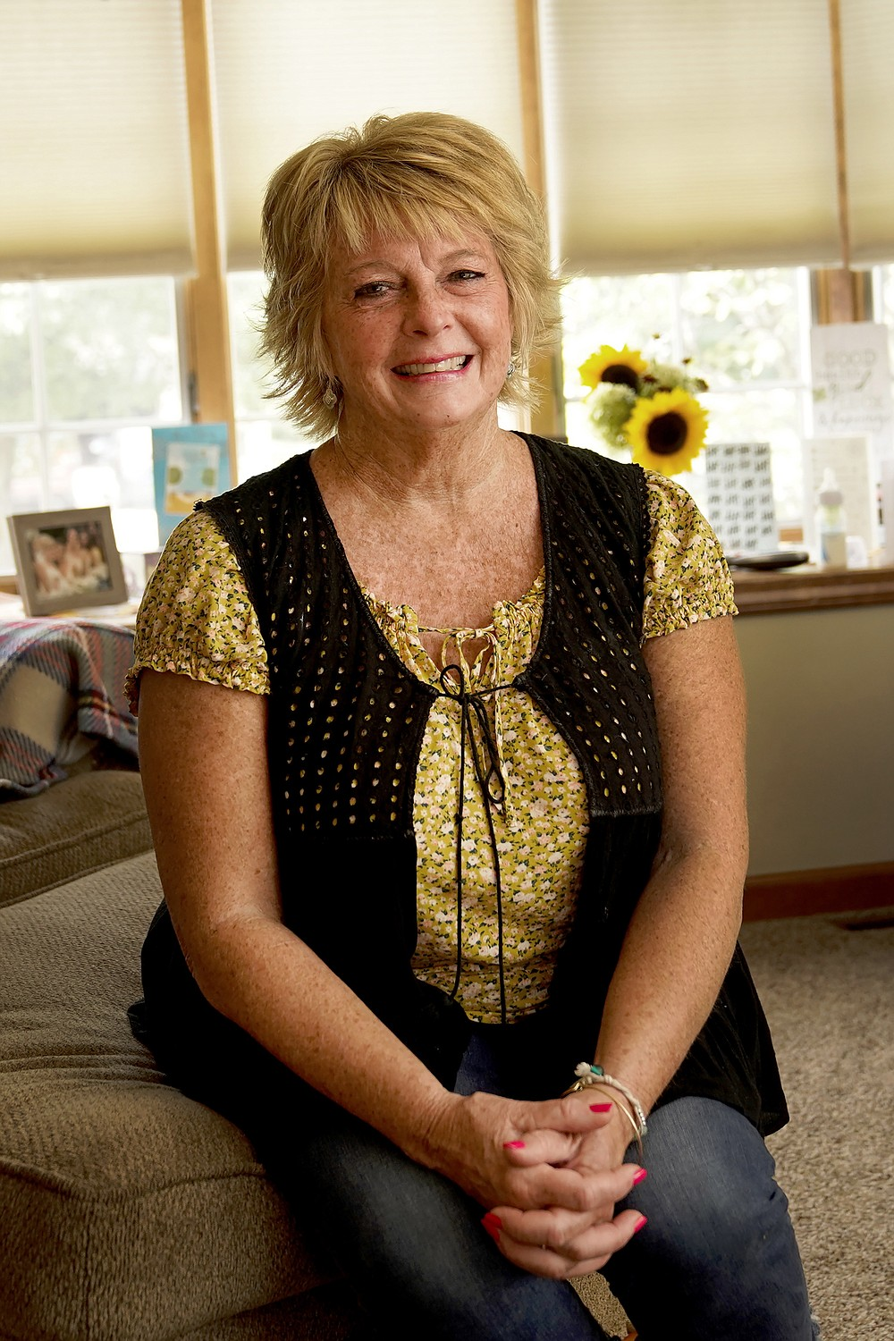 """Kay Orzechowicz poses Wednesday, Sept. 2, 2020, for a portrait at her Griffith, Ind., home. After 35 years of teaching, Orzechowicz said COVID-19 """"pushed her over the edge"""" to retire from northwest Indiana's Griffith High School at the end of July.  (AP Photo/Charles Rex Arbogast)"""