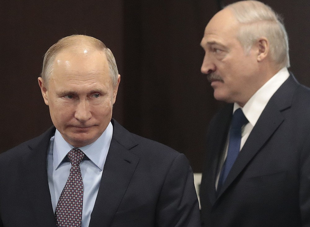FILE- In this file photo taken on Friday, Feb. 15, 2019, Russian President Vladimir Putin, left, and Belarusian President Alexander Lukashenko meet in the Black sea resort of Sochi, Russia.  Alexander Lukashenko's talks with Russian President Vladimir Putin on Monday Sept. 14, 2020, in the Black Sea resort of Sochi come a day after an estimated 150,000 people flooded the streets of the Belarusian capital, demanding Lukashenko's resignation. (Sergei Chirikov/Pool Photo via AP, File)