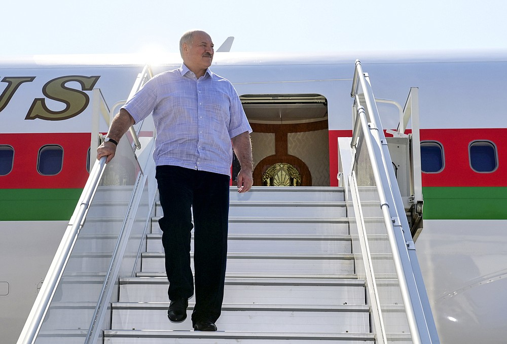 Belarusian President Alexander Lukashenko steps down from his plane upon his arriving at the Black Sea resort of Sochi, Russia, Monday, Sept. 14, 2020.  Belarus' authoritarian president, Lukashenko is visiting Sochi for talks with Russian President Vladimir Putin a day after an estimated 150,000 flooded the streets of the Belarusian capital, demanding Lukashenko's resignation. (Andrei Stasevich /BelTA Pool Photo via AP)
