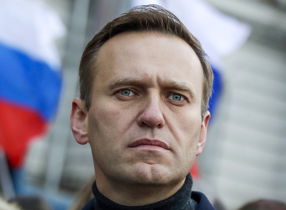 FILE - In this Saturday, Feb. 29, 2020 file photo, Russian opposition activist Alexei Navalny takes part in a march in memory of opposition leader Boris Nemtsov in Moscow, Russia. The German government says specialist labs in France and Sweden have confirmed Russian opposition leader Alexei Navalny was poisoned with the Soviet-era nerve agent Novichok. (AP Photo/Pavel Golovkin, File)