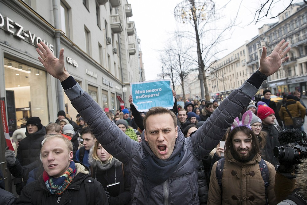FILE - In this Sunday, Jan. 28, 2018 file photo, Russian opposition leader Alexei Navalny, center, attends a rally in Moscow, Russia. The German government says specialist labs in France and Sweden have confirmed Russian opposition leader Alexei Navalny was poisoned with the Soviet-era nerve agent Novichok. (AP Photo/Evgeny Feldman, File)