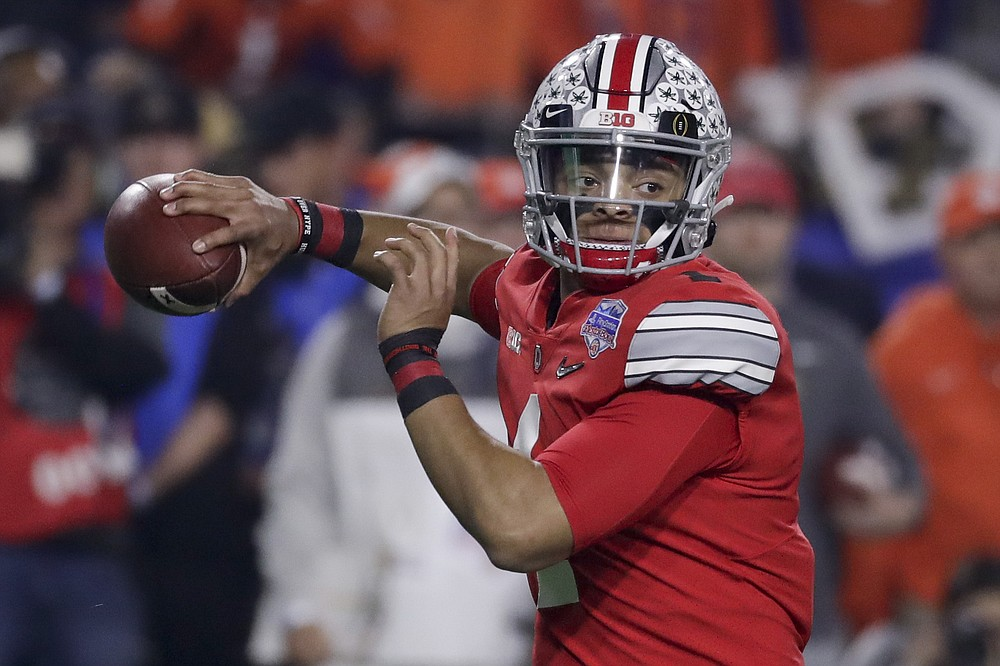 FILE - In this Dec. 28, 2019, file photo, Ohio State quarterback Justin Fields throws a pass against Clemson during the first half of the Fiesta Bowl NCAA college football playoff semifinal, in Glendale, Ariz. Clemson is preseason No. 1 in The Associated Press Top 25, Monday, Aug. 24, 2020, a poll featuring nine Big Ten and Pac-12 teams that gives a glimpse at what's already been taken from an uncertain college football fall by the pandemic. Ohio State was a close No. 2. (AP Photo/Rick Scuteri, File)