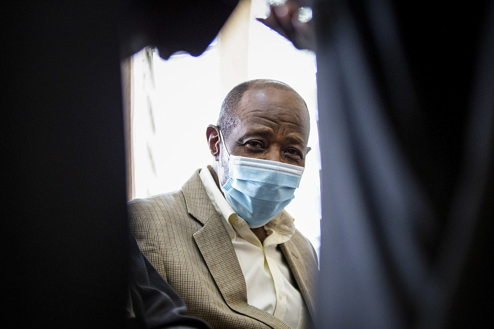 "Paul Rusesabagina, who inspired the film ""Hotel Rwanda"" for saving people from genocide, appears at the Kicukiro Primary Court in the capital Kigali, Rwanda Monday, Sept. 14, 2020. Rusesabagina became famous for protecting more than 1,000 people as a hotel manager during Rwanda's 1994 genocide and was awarded the U.S. Presidential Medal of Freedom in 2005 but Rwandan authorities accused him of supporting the armed wing of his opposition political platform, which has claimed responsibility for deadly attacks inside Rwanda. (AP Photo)"