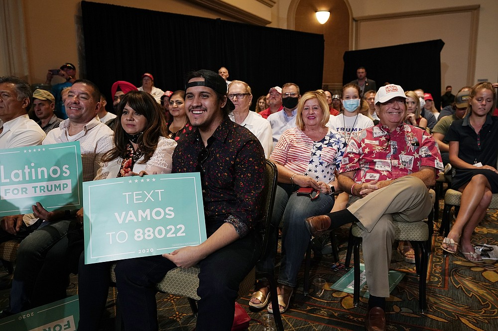 The crowd listens to President Donald Trump speak as he participates in a Latinos for Trump Coalition roundtable Monday, Sept. 14, 2020, in Phoenix. (AP Photo/Ross D. Franklin)