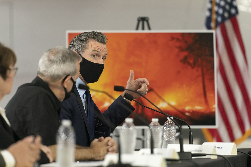California Gov. Gavin Newsom speaks during a briefing with President Donald Trump at Sacramento McClellan Airport, in McClellan Park, Calif., Monday, Sept. 14, 2020, on the wildfires. (AP Photo/Andrew Harnik)