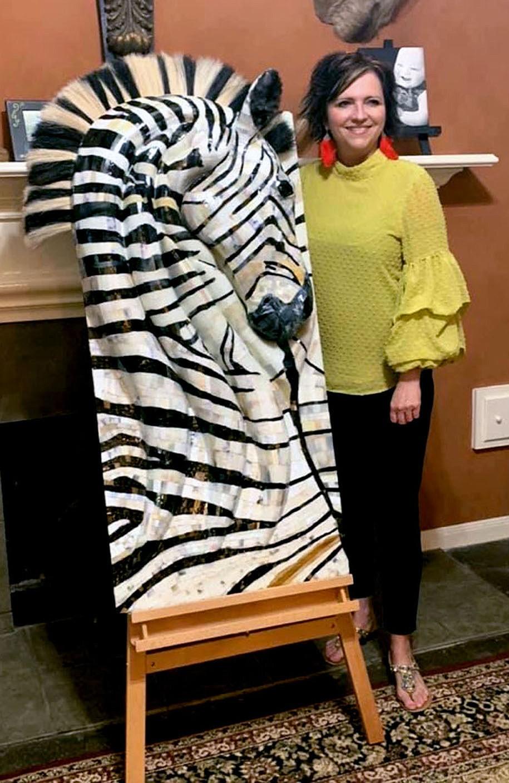 "Janelle Jessen/Herald-Leader Artist Amy Haid poses with a zebra sculpture titled ""Mistari Maridadi."""