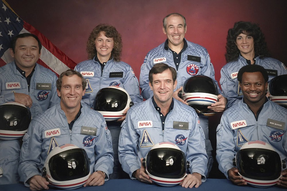 """This image released by Netflix shows members of the Challenger 7 crew, from left, Ellison S. Onizuka; Mike Smith; Christa McAuliffe; Dick Scobee; Gregory Jarvis; Judith Resnik; and Ronald McNair in episode 2 of """"Challenger: The Final Flight."""" The four-part series about the 1986  Challenger space shuttle disaster premieres Wednesday. (NASA/Netflix via AP)"""