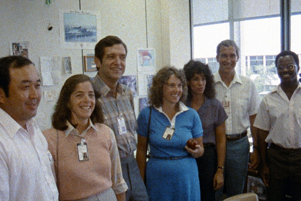 """This image released by Netflix shows members of the Challenger 7 crew, from left, Ellison S. Onizuka; Barbara Morgan, Dick Scobee, Christa McAuliffe, Judith Resnik, Mike Smith, and Ronald McNair in episode 2 of """"Challenger: The Final Flight."""" The four-part series about the 1986  Challenger space shuttle disaster premieres Wednesday. (NASA/Netflix via AP)"""