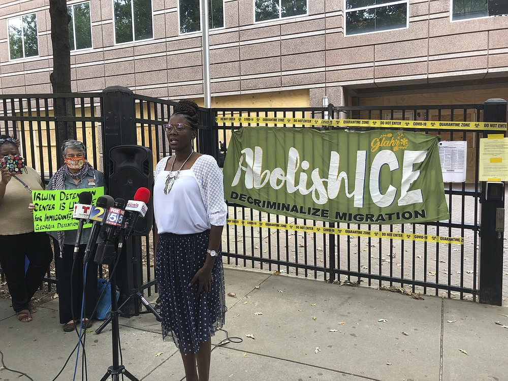 Dawn Wooten, a nurse at Irwin County Detention Center in Ocilla, Georgia, speaks at a Tuesday, Sept. 15, 2020 news conference in Atlanta protesting conditions at the immigration jail. Wooten says authorities denied COVID-19 tests to immigrants, performed questionable hysterectomies and shredded records in a complaint filed to the inspector general of the U.S. Department of Homeland Security. (AP Photo/Jeff Amy)