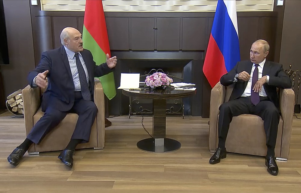 In this photo taken from video and released by Russian Presidential Press Service, Russian President Vladimir Putin, right, and Belarusian President Alexander Lukashenko talk during their meeting in the Bocharov Ruchei residence in the Black Sea resort of Sochi, Russia, Monday, Sept. 14, 2020. Belarus' authoritarian president is visiting Russia in a bid to secure more loans and political support as demonstrations against the extension of his 26-year rule enter their sixth week. Alexander Lukashenko's talks Monday with Russian President Vladimir Putin in the Black Sea resort of Sochi come a day after an estimated 150,000 flooded the streets of the Belarusian capital, demanding Lukashenko's resignation. (Russian Presidential Press Service via AP)
