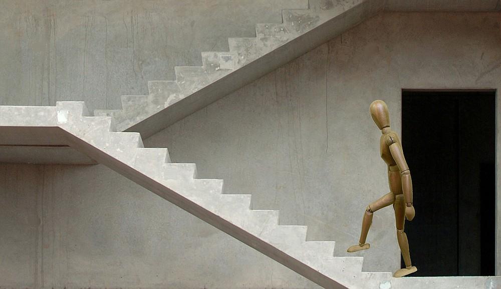 Stickman demonstrates step 2 of the Alternating Stair Climb for Matt Parrott's Master Class. (Arkansas Democrat-Gazette/Celia Storey)