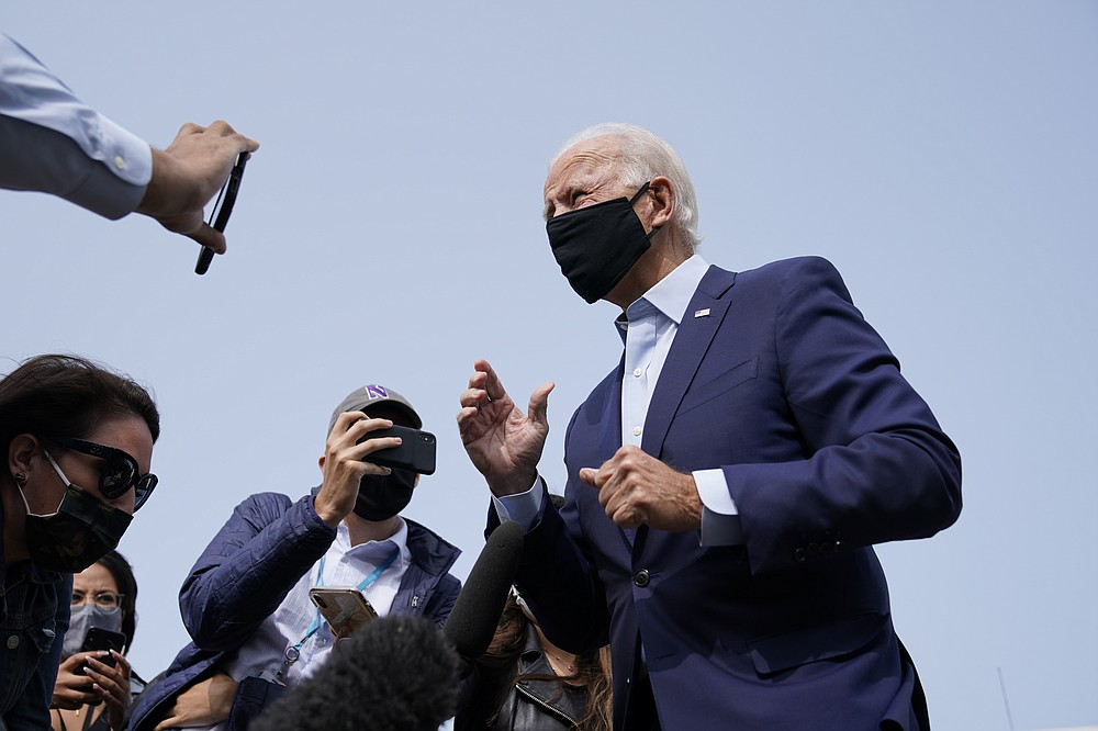 Democratic presidential candidate and former Vice President Joe Biden arrives and speaks to the media before boarding a plane at New Castle Airport in New Castle, Del., Tuesday, Sept. 15, 2020. Biden is traveling to Florida for campaign events. (AP Photo/Patrick Semansky)